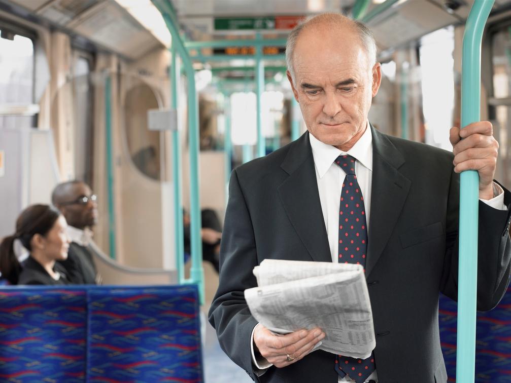 a Businessman reading a newspaper