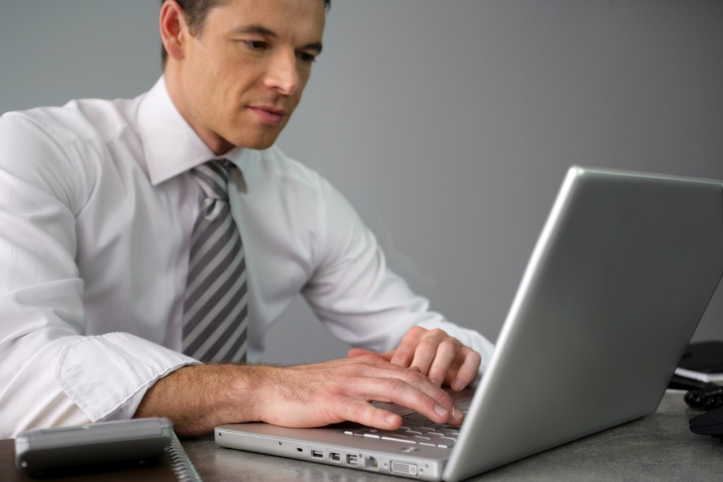 A business man in front of his laptop
